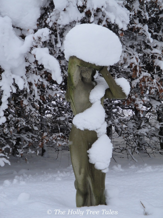 DSC09448 - Girl statue embraced by snow. Legerwood. Garden.  - copyright The Holly Tree Tales. com.