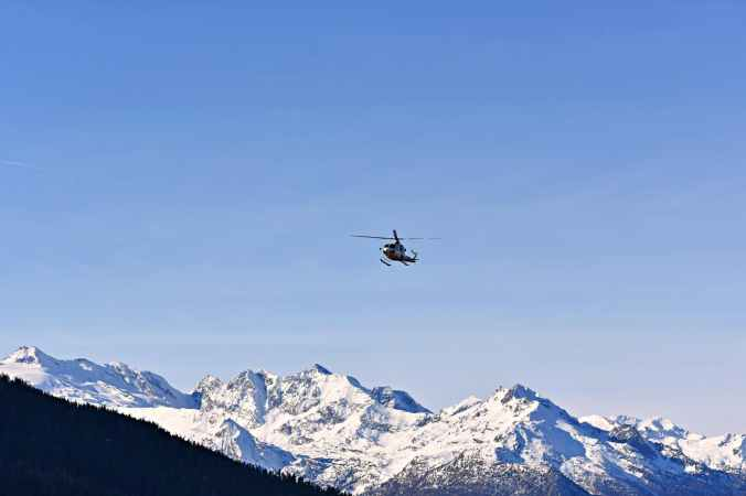 Helicopter approaching. Success. Mission. Peacemakers. Heroes.  Rescue. Focus.  Blue Sky. Mountains. Snowy Peaks. Freedom.  Happiness -  Image via the internet.