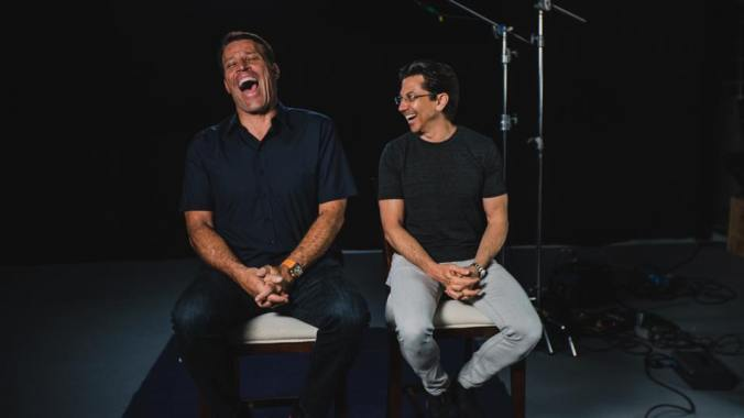 Tony Robbins and Dean Graziosi, having a chuckle.